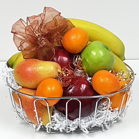A comforting fruit assortment carefully nestled in a beautiful stainless steel fruit gift basket.