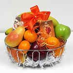 A lovely fruit gift basket nestled with some tasty fruit, specialty coffee and tea.