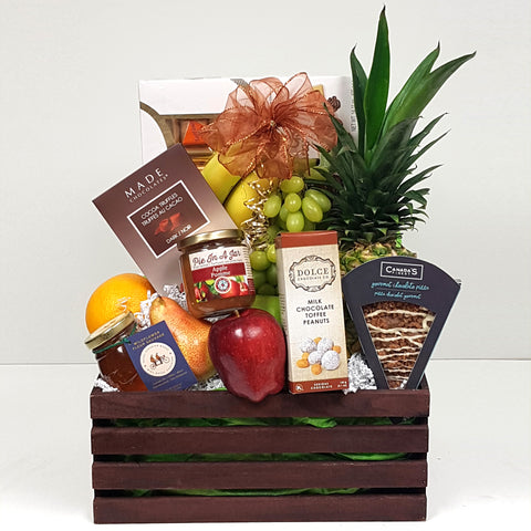 A beautiful selection of fresh fruit, specialty treats, honey, chocolates and more creatively arranged in a handy wooden crate fruit gift basket.