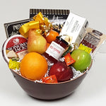 A delightful fruit gift basket filled with tantalizing savoury shortbread, red pepper jelly, cheese, pepperoni, sweet & salty snacks served up with fruit.