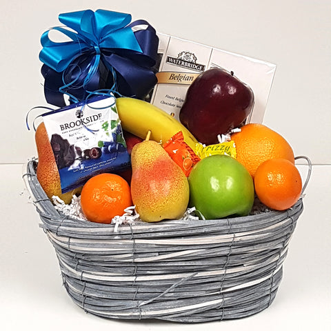 A wonderful fruit gift basket with a simple assortment of fruits to enjoy with a few little somethings to satisfy the sweet tooth.