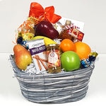 A pretty fruit gift basket brimming with delicious chocolate, maple syrup, sparkling jelly, fruit, cookies and sparkling water too!