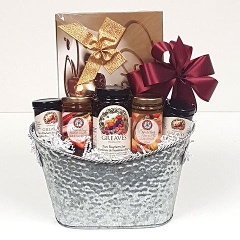 A designer silver gourmet gift basket tin filled with a variety of Greaves Jams from Niagara on the Lake together with lovely Cider Keg sparkling jellies, and a lovely box of European chocolates.
