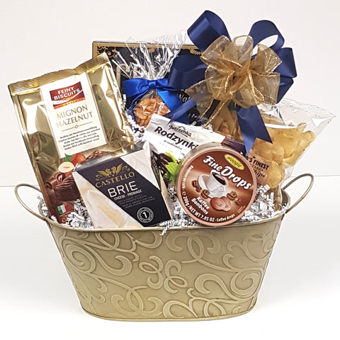 A vanilla colored swirl tin gift basket loaded with crackers, cheese, nuts, tasty chocolates, candies and more.