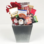 A lovely tall tin gift basket brimming with coffee and tea, a yummy pancake mix with maple syrup, some jams and jellies, cookies and truffles.