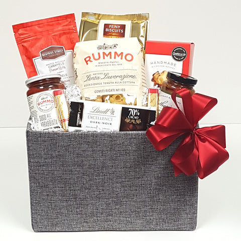 A  gourmet gift basket filled with delectables for the pantry such as pasta and Italian pasta sauce, there's antipasto, utterly delicious handmade shortbreads, chocolates and biscuits too.