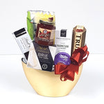 A pretty half moon gold container gift basket filled with cheese, crackers, red pepper jelly, savoury shortbread, truffles and chocolate too.