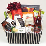 A pretty fabric gift basket containing a pizza grill stone, gourmet pizza sauce, Italian pasta sauce, Rummo pasta, Cider Keg apple cider, cheese, crackers and savoury shortbread to enjoy.