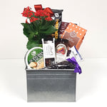 A pretty garden tin gift basket loaded with cheese, chocolate, jam, cookies and a potted plant to enjoy.