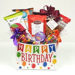 The perfect birthday gift basket brimming with birthday wishes of all sorts and loads of sweet and salty treats.