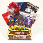 A specialty birthday cake gift basket that's overflowing with sweet & salty snacks of all kinds.