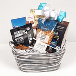 A sweet & salty gift basket containing nuts, chocolate, pretzels and pita chips to enjoy.
