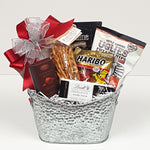 A pretty silver tin gift basket filled with licorice, truffles. Lindt chocolate, pretzels, gummy bears, potato chips and more.