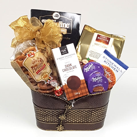 A sweet and salty gift basket filled with wafer rolls, Mignon Hazelnut biscuits, a maple butter wafer biscuit, Brezeln puff biscuits and shortbread too.