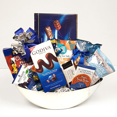 A pretty silver half moon container containing a delectable assortment of chocolates, nuts and chips too!