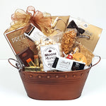 A beautiful tin gift basket brimming with peanut brittle, moose munch, nuts, truffles and pretzels too.