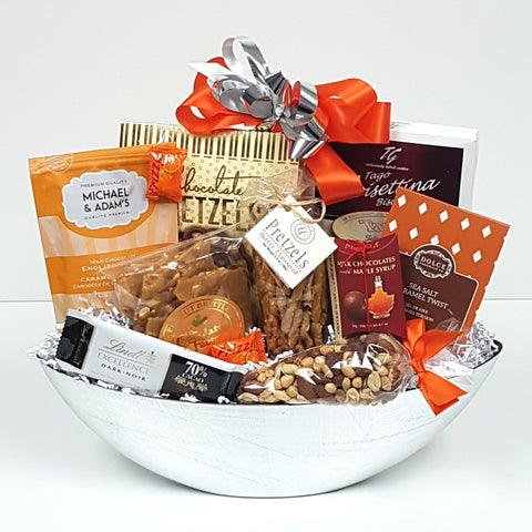 A sweet & salty gift basket filled up with peanut brittle, pretzels, nuts, chocolates, caramel twists and more.