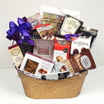 A sweet & salty gift basket containing European chocolates, toffees, salty bar mix, Godiva chocolates, cookie dough bites, brittle, licorice and many other delightful treats.