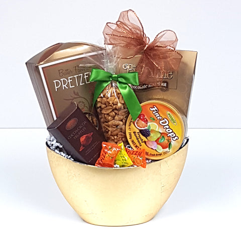 A pretty golden half moon gift basket filled with sweet & salty treats to soothe the soul.