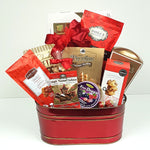 A sweet & salty gift basket holding handmade shortbread, maple roasted cashews, fine candy drops, delectable chocolate, pretzels and some maple caramel crunch.