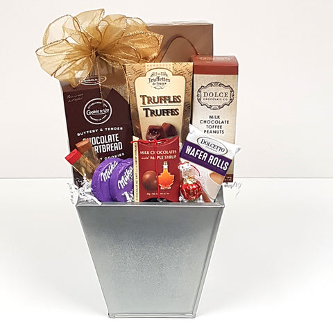 A weet & salty gift basket loaded with a decadent assortment of truffles, European chocolates, chocolate shortbread, chocolate covered toffee peanuts, chocolate wafer rolls, chocolate with maple syrup and more.