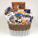 A sweet & salty gift basket containing European chocolates, Uglies potato chips, chocolate seashells to Martin's apple chips, Godiva chocolates, nuts, pretzels, salsa and much more