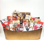 Gold tin Christmas gift basket overflowing with gourmet chutney, mustard, sparkling cranberry cider, coffee, tea, hot chocolates, Sea Change salmon, crackers, cheese and sweets galore.