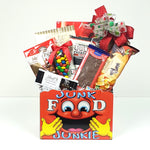A Christmas gift basket filled with an assortment of cookies, chocolates, maple popcorn, Uglies potato chips, pretzels and more.