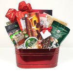 A  Christmas gift basket filled with a delicious assortment of sweets, cheese, crackers and pepperoni.