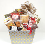 A pretty gold polka dot fabric Christmas gift basket filled with crackers and cheese, lots of chocolates, pretzels, nuts, snack mix, salt water taffy and cookies too!