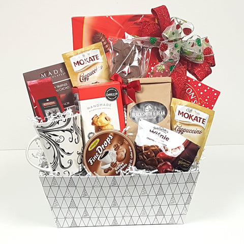 A Christmas gift basket is complete with a pretty mug to keep, the coffee lover will indulge in a variety of coffees, coffee candy drops, shortbread, truffles and a cute chocolate Rudolph lolly too.