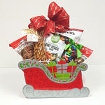 Red Santa's sleigh Christmas gift basket filled with lots of sweet and salty treats.