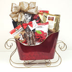 A Christmas gift basket consists of Santa's elegant sleight that holds Martin's apple chips, Feiny hazelnut biscuits, cashews, jelly beans and much more.