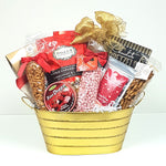 A sparkling gold tin Christmas gift basket filled with nuts, pretzels, peppermint candy kisses, Christmas chocolate gems, fine candy drops, maple caramel crunch, licorice and more.