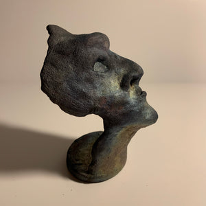 Raku clay sculpture, staring face. AGE