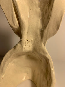 Faceless lady, White glazed sculpture. AGE