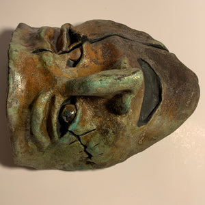 Raku clay sculpture mask, slit eye glazed stare. AGE