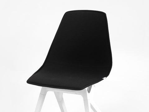 Black New Zealand Wool topper on a white noho move chair