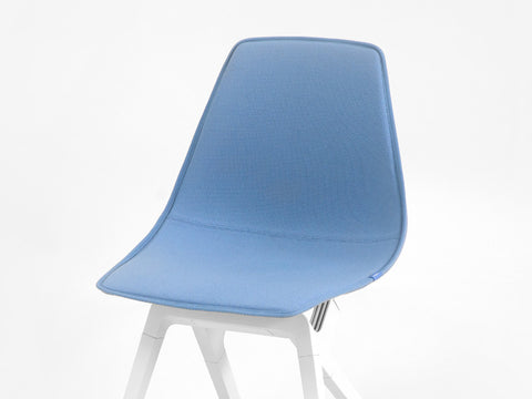 Blue New Zealand Wool topper on a white noho move chair