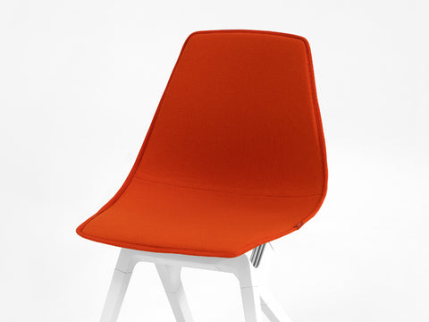 Orange New Zealand Wool topper on a white noho move chair