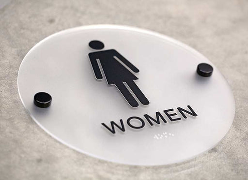 Round restroom signs with black stand offs