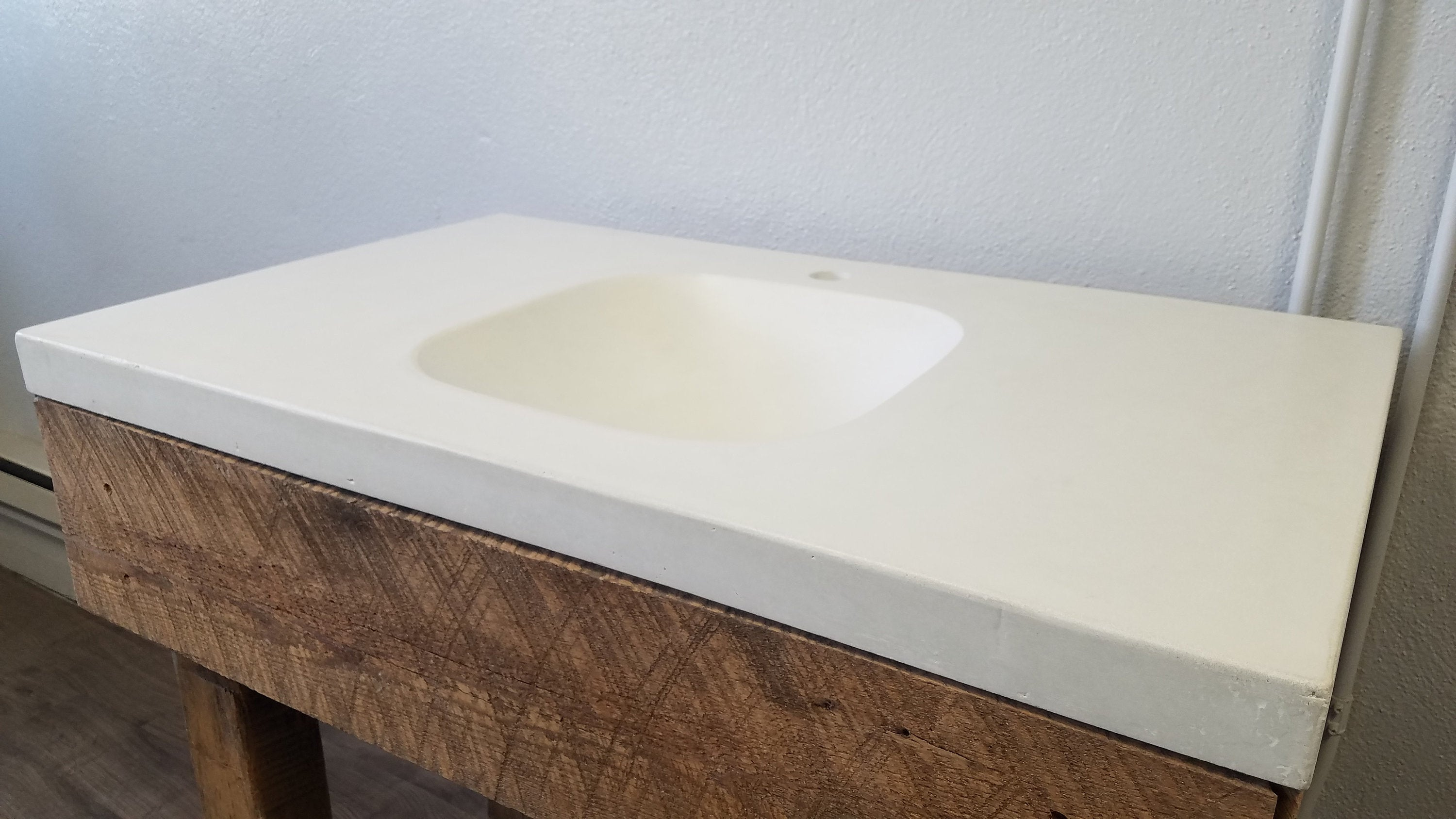 Concrete vanity top with integral sink