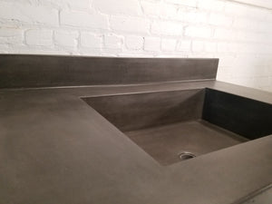 Concrete vanity top with integral sink and backsplash