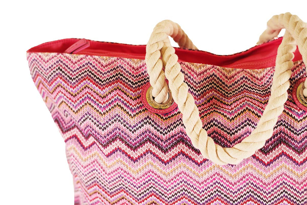 Pink beach bag with white cords handles