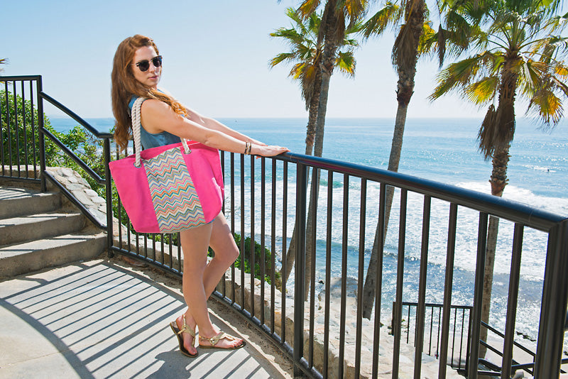 Californian girl wearing a pink beach bag tote