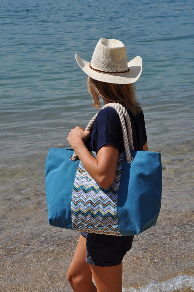 women on a beach with a canvas beach tote