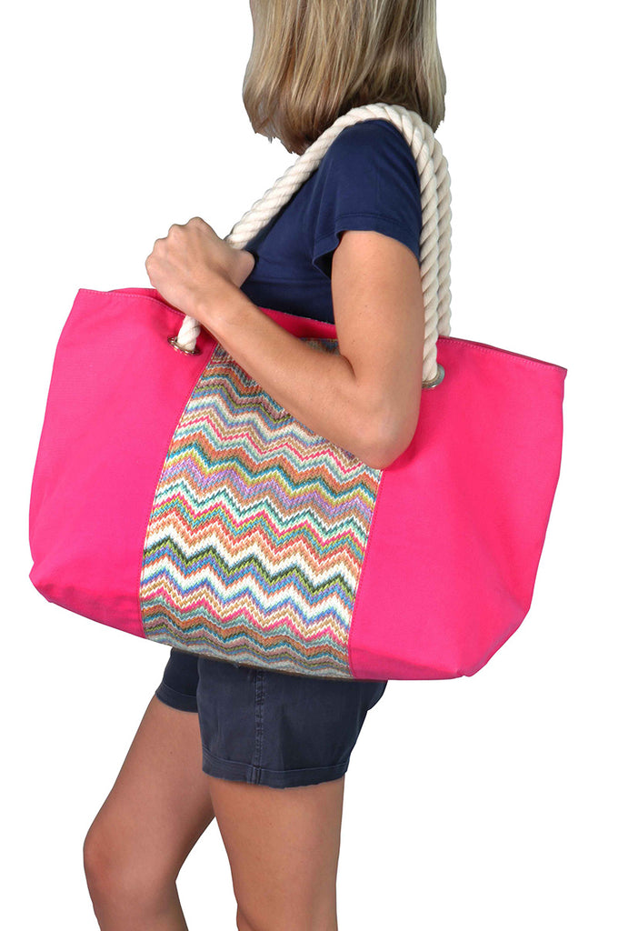 Woman wearing a pink beach bag with cotton handles