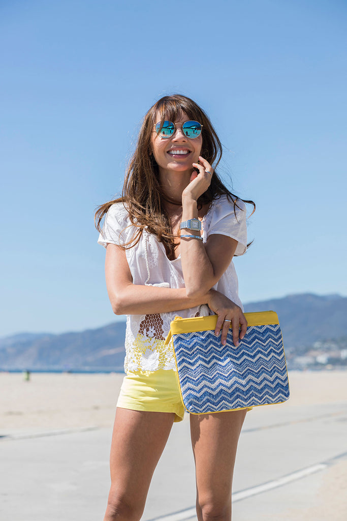 woman with a blue and yellow bikini pouch at the beach
