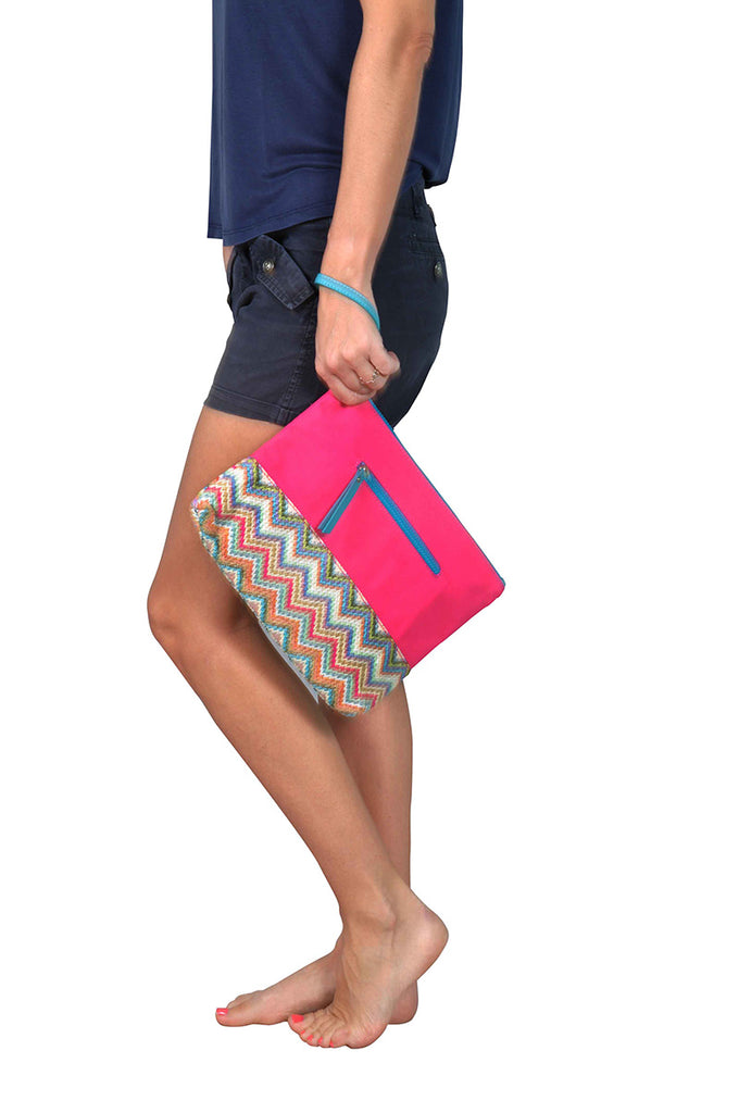 woman with pink beach pouch