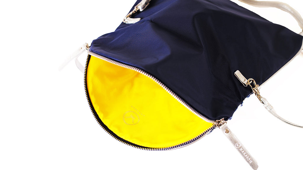 Navy blue crossbody bag with yellow lining